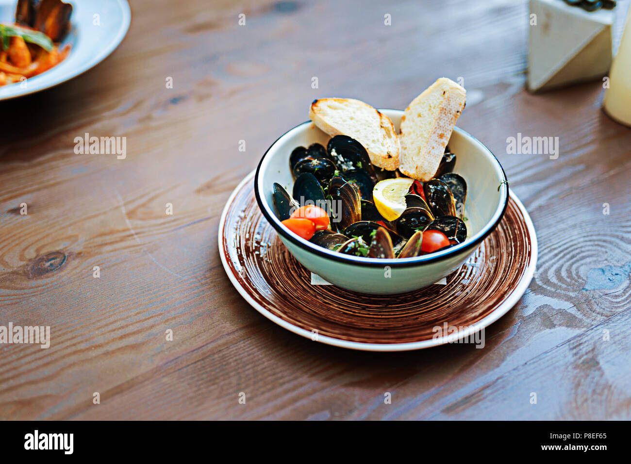 Yummy seafood dish standing on the table in restaurant - Stock Image