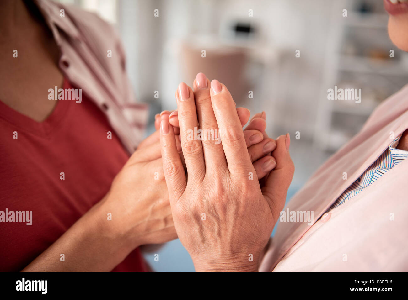 Devoted daughter feeling appreciation coming to her mother - Stock Image