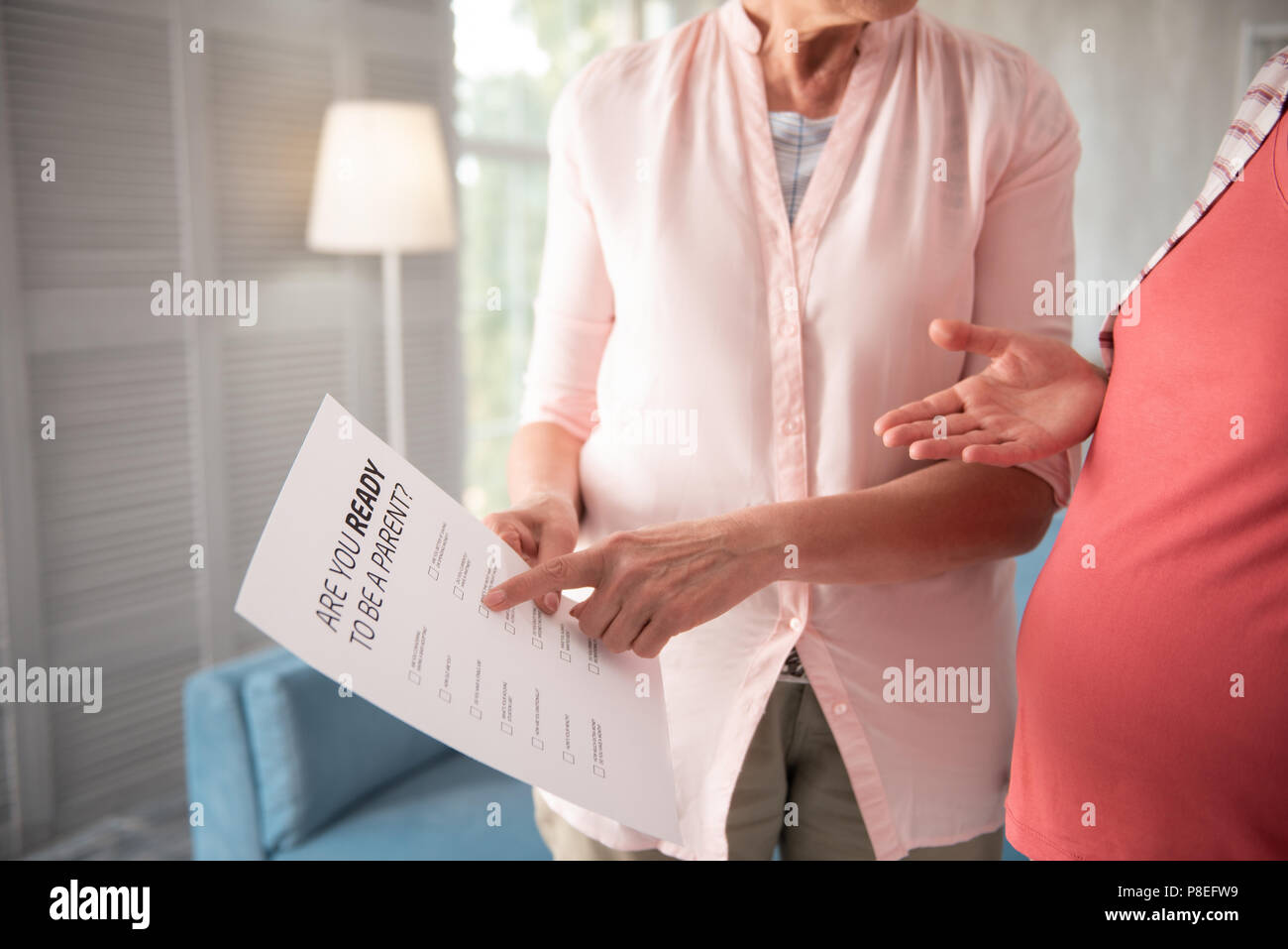 Helpful sociologist making poll for pregnant women - Stock Image