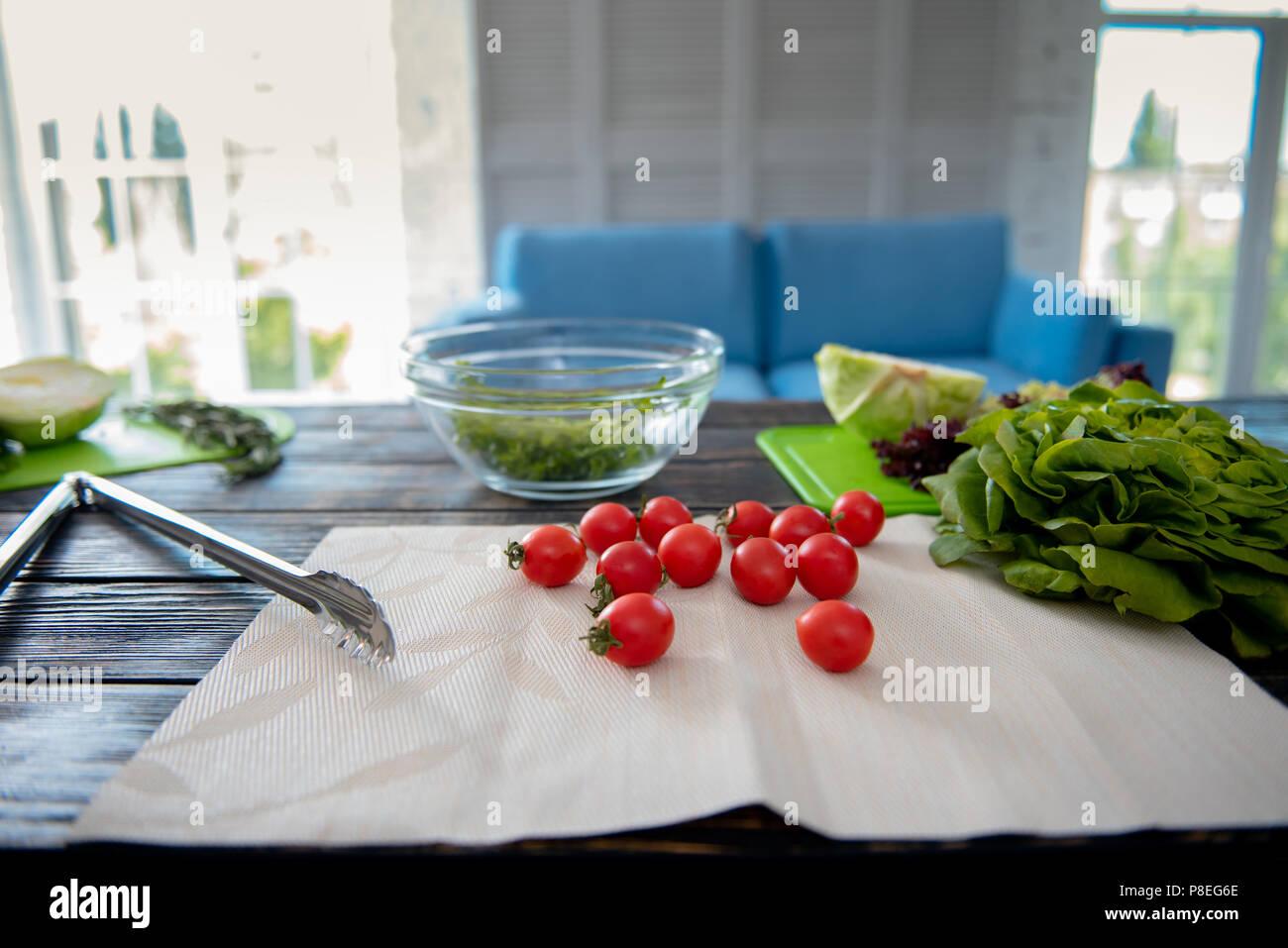 Savory cherry tomatoes lying on the napkin - Stock Image