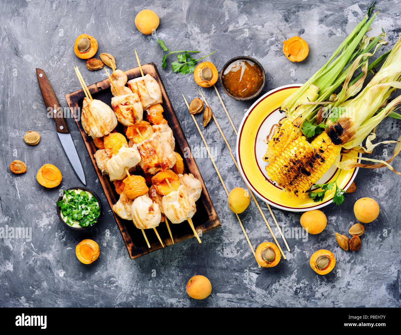 Shish kebab with turkey meat, cooked with apricots on skewers.Food for a picnic. - Stock Image