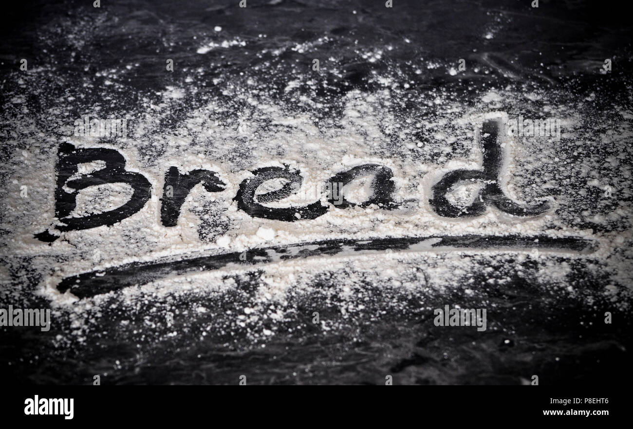Bread written in flour - Stock Image