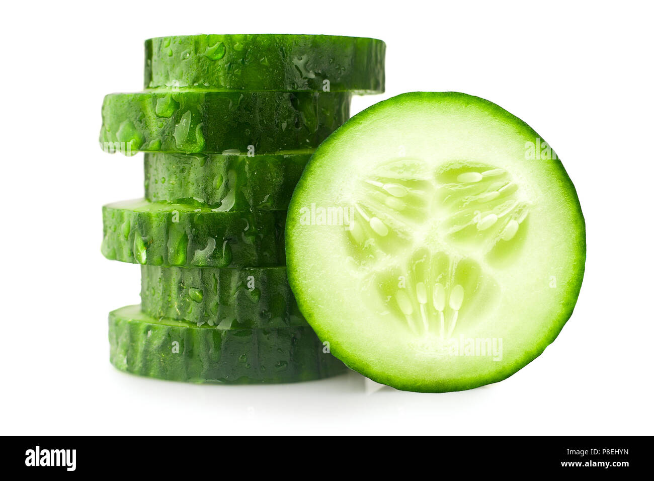 fresh juicy slice cucumber on a white background, isolated - Stock Image