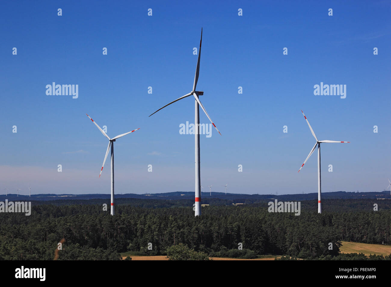 Wind generators, Windmills in the landscape, Windgeneratoren in der Landschaft, Bayern, Deutschland - Stock Image