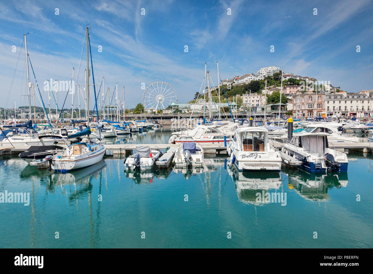 21 May 2018: Torquay, Devon, England, UK - The marina and town on a sunny spring day. - Stock Image