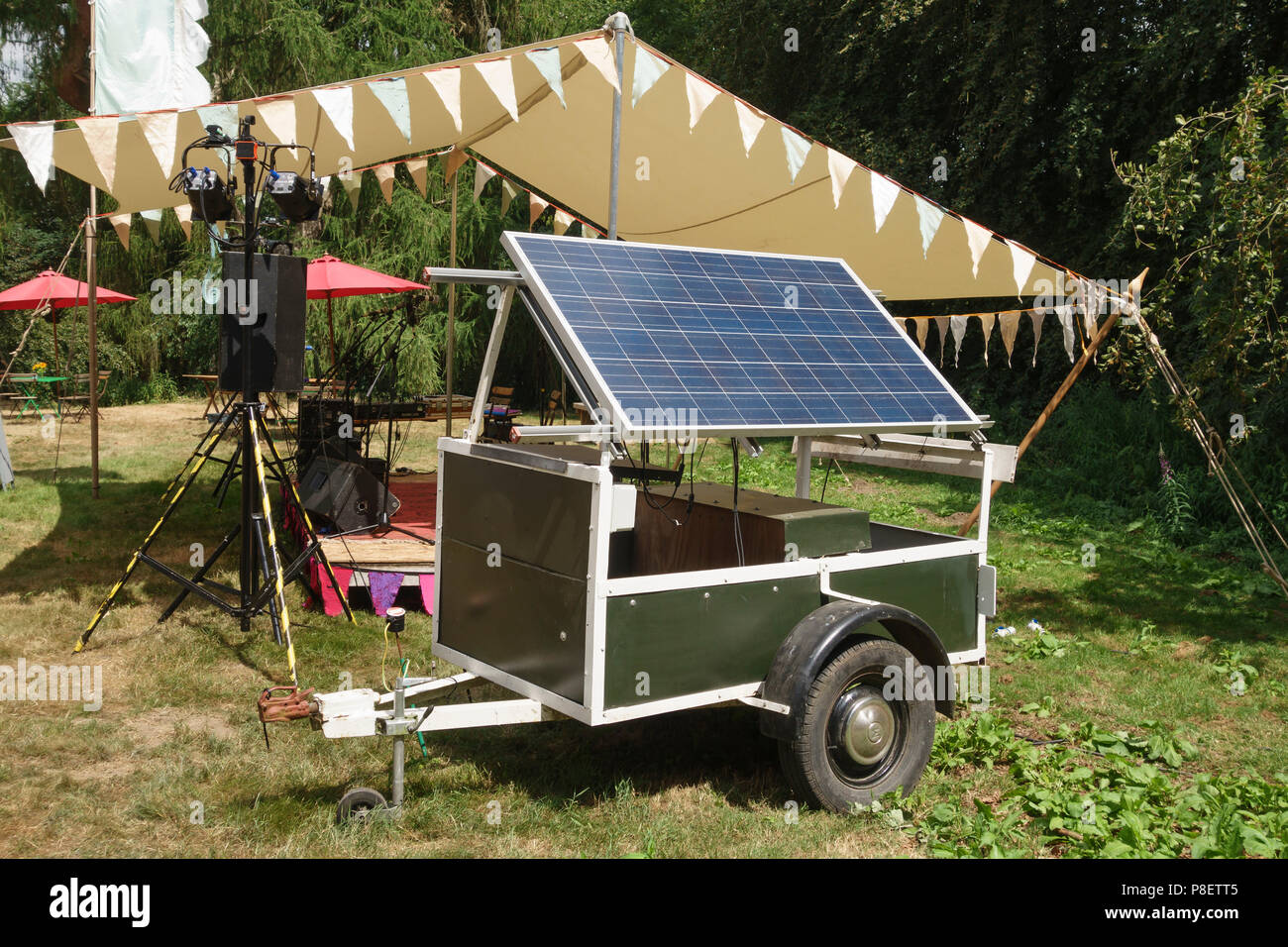UK. A portable solar-powered generator provides free power at an open air music festival in summer - Stock Image