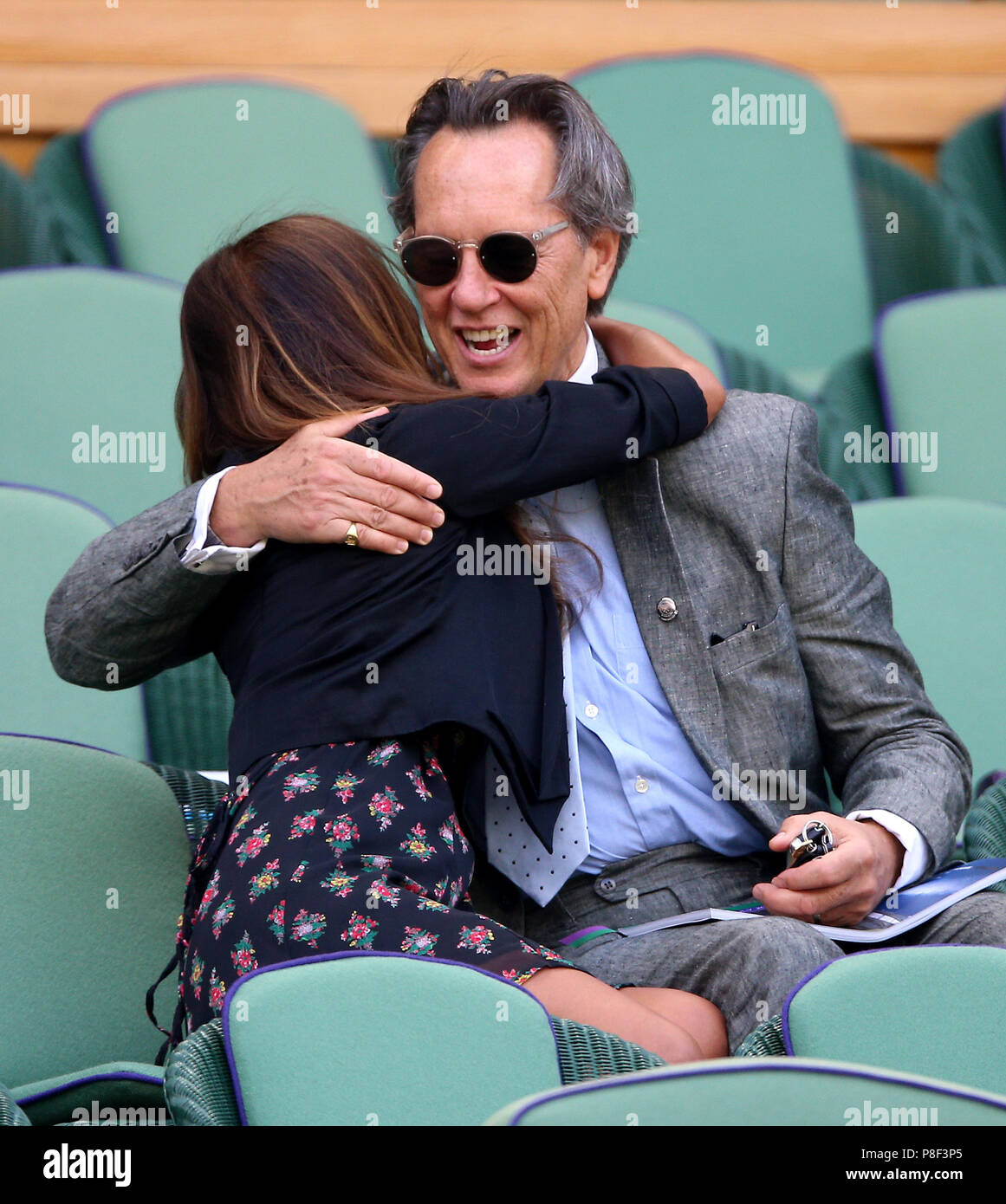 Richard E. Grant and Binti Velani in the royal box on centre court on day nine of the Wimbledon Championships at the All England Lawn Tennis and Croquet Club, Wimbledon. Stock Photo