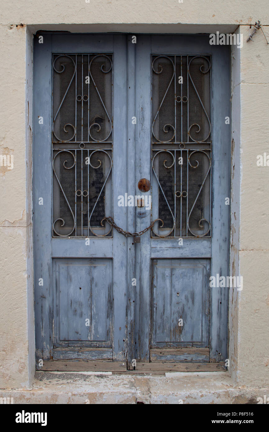 The blue door saves the secrets behind - Stock Image