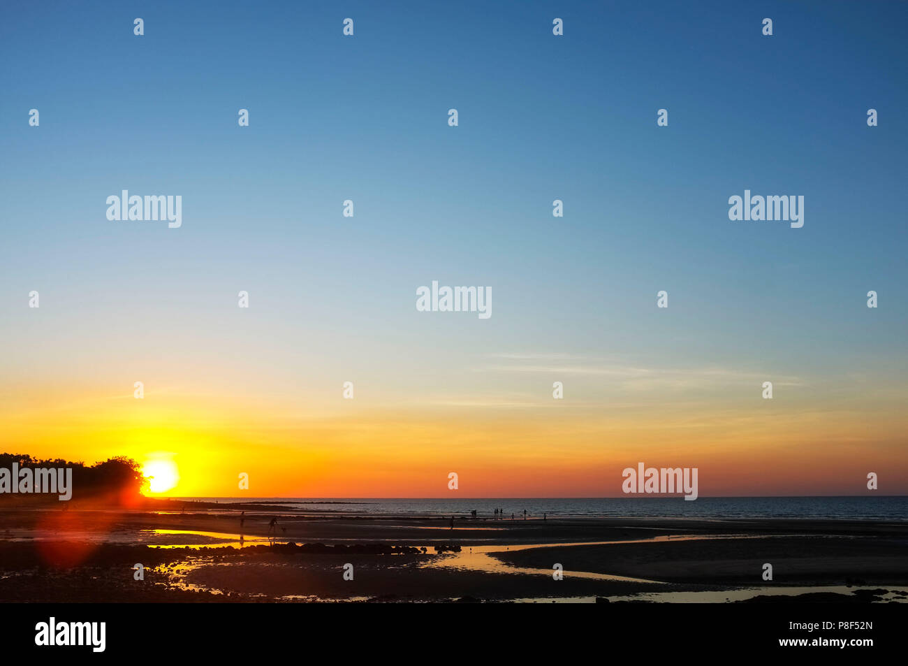 Nightcliff beach at sunset, with people silhouettes. In a suburb of Darwin NT Australia. - Stock Image