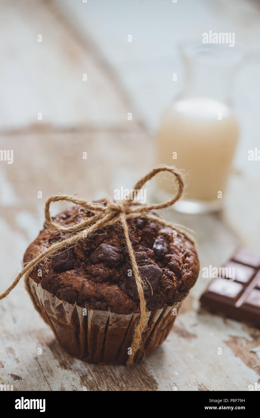 Dellicious homemade chocolate muffin on table. Ready to eat. - Stock Image