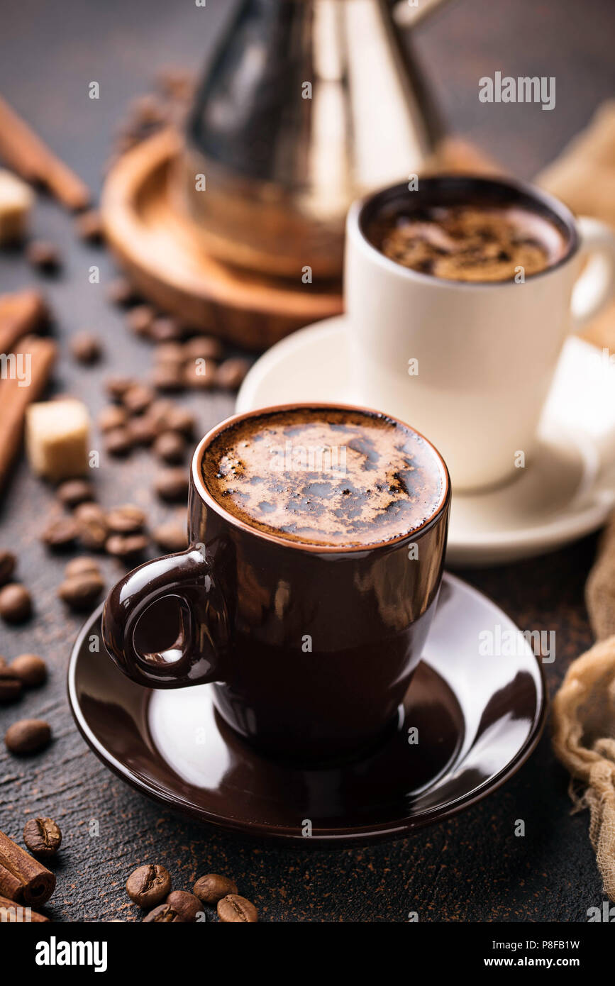 Cups of coffee, beans, sugar and cinnamon - Stock Image