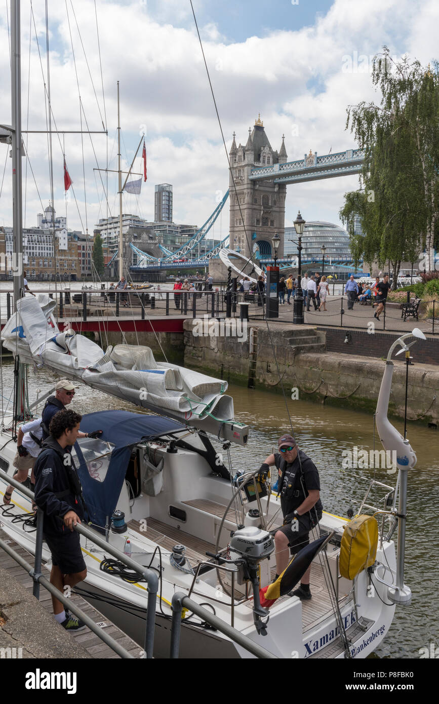a large sailing yacht in the lock at st katherine docks in central london. - Stock Image