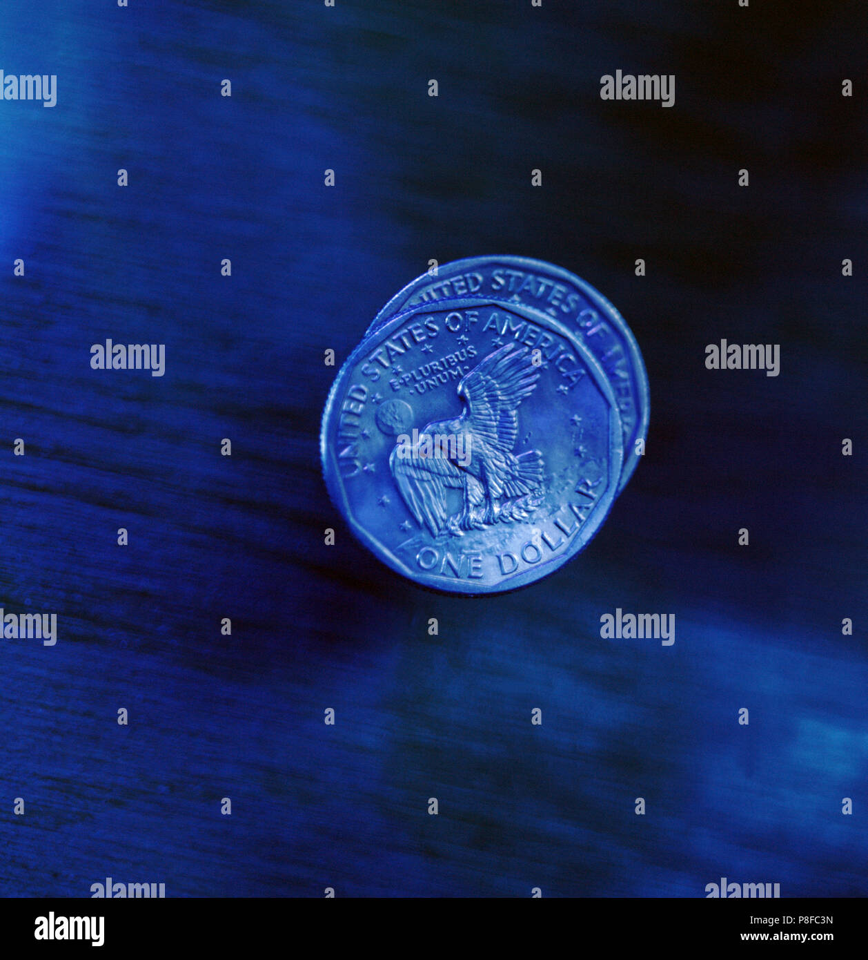 2 American Dollar Coin Blue Cast - Stock Image