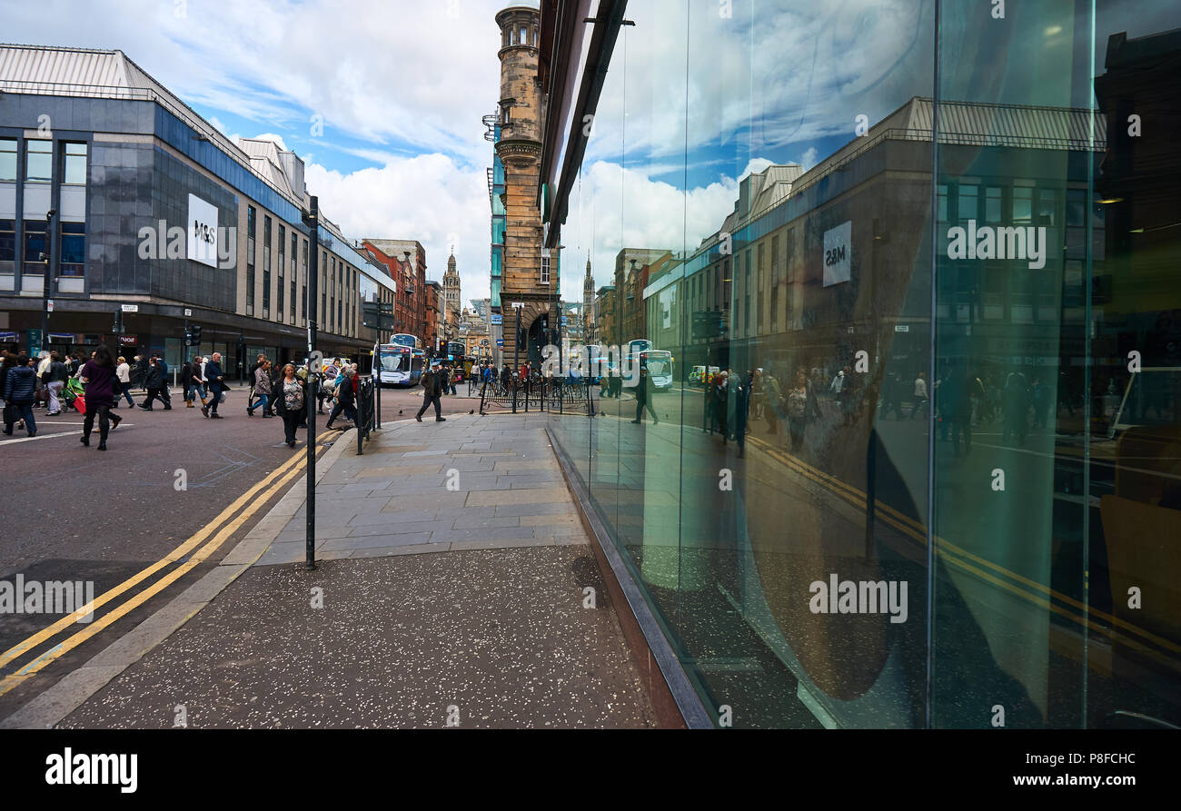 Stockwell Street in Glasgow, UK, reflected in a shop front windows. - Stock Image