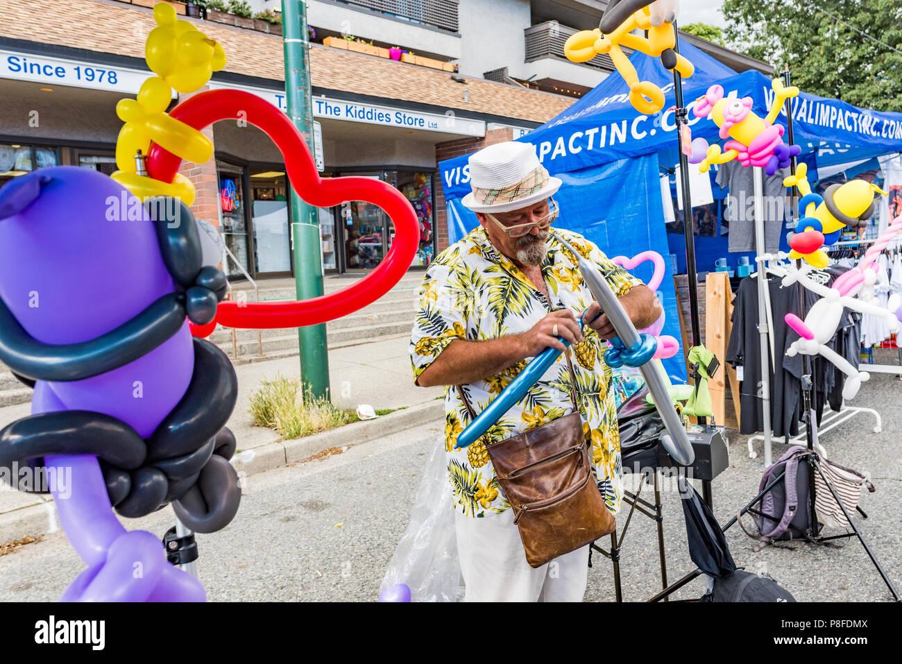 Balloon man, Khatsalano Festival, Kitsilano, Vancouver, British Columbia, Canada. - Stock Image