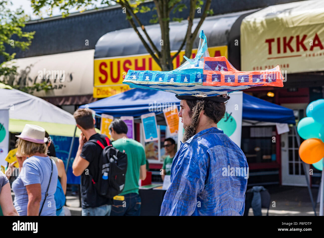 ff63cea7f3e Man with papier mache Seabus hat, Car Free Day, Commercial Drive, Vancouver,