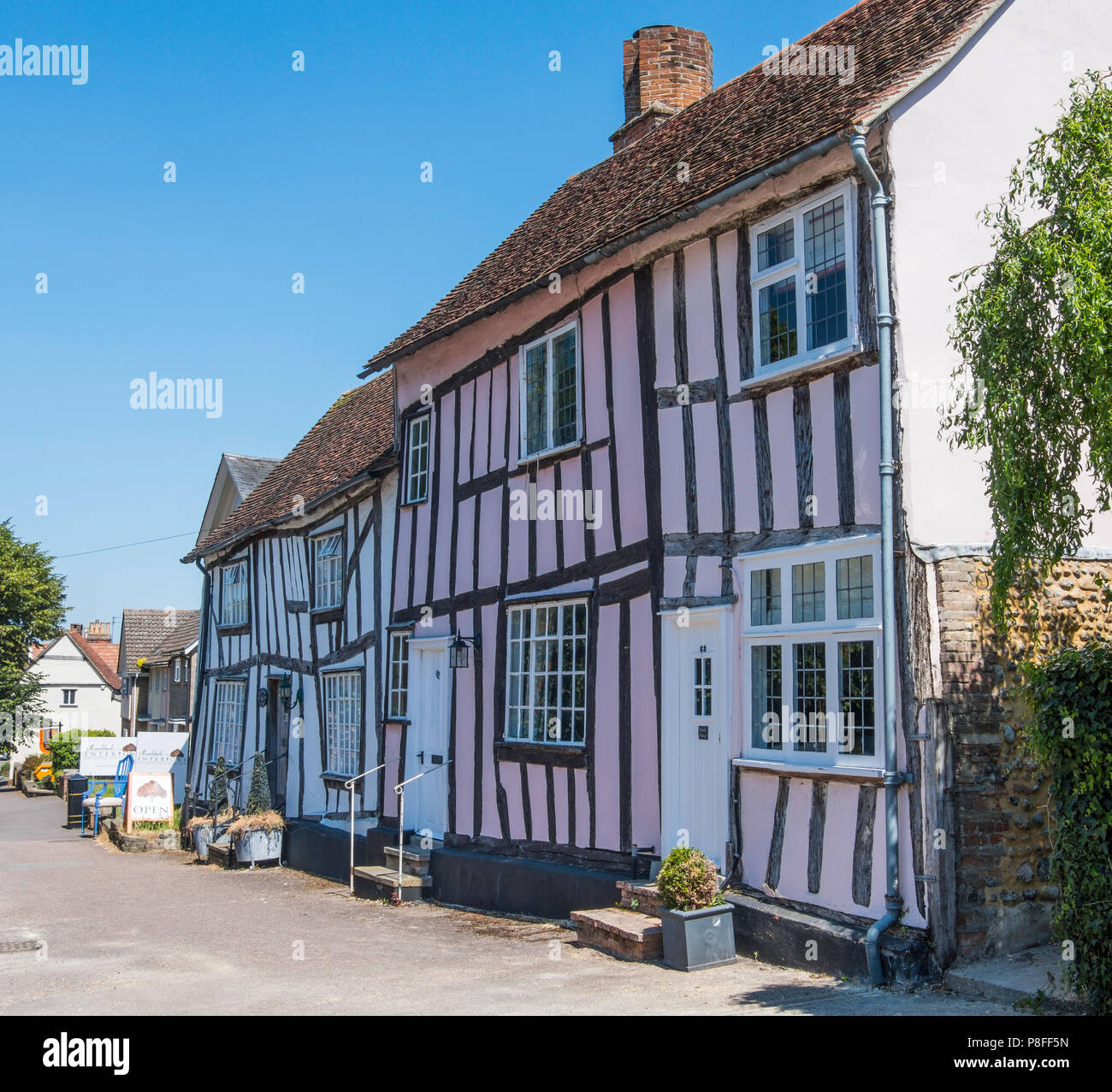 Timber framed buildings in Lavenham a town noted for its 15th-century church and half-timbered medieval cottages. - Stock Image