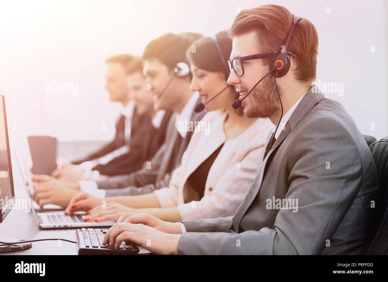 colleagues call centre workplace in the office - Stock Image