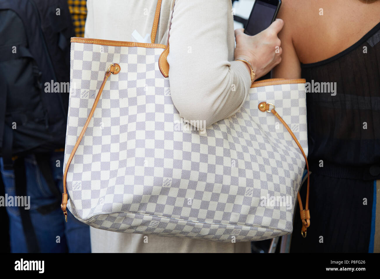 7fde1a8ffdcd MILAN - JUNE 15  Woman with gray and white checkered Louis Vuitton bag  before Alberta Ferretti fashion show
