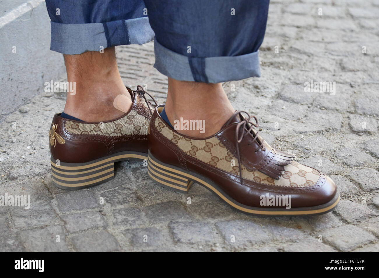 a275b0403043 MILAN - JUNE 16  Man with brown leather Gucci shoes and blue jeans before  Marni