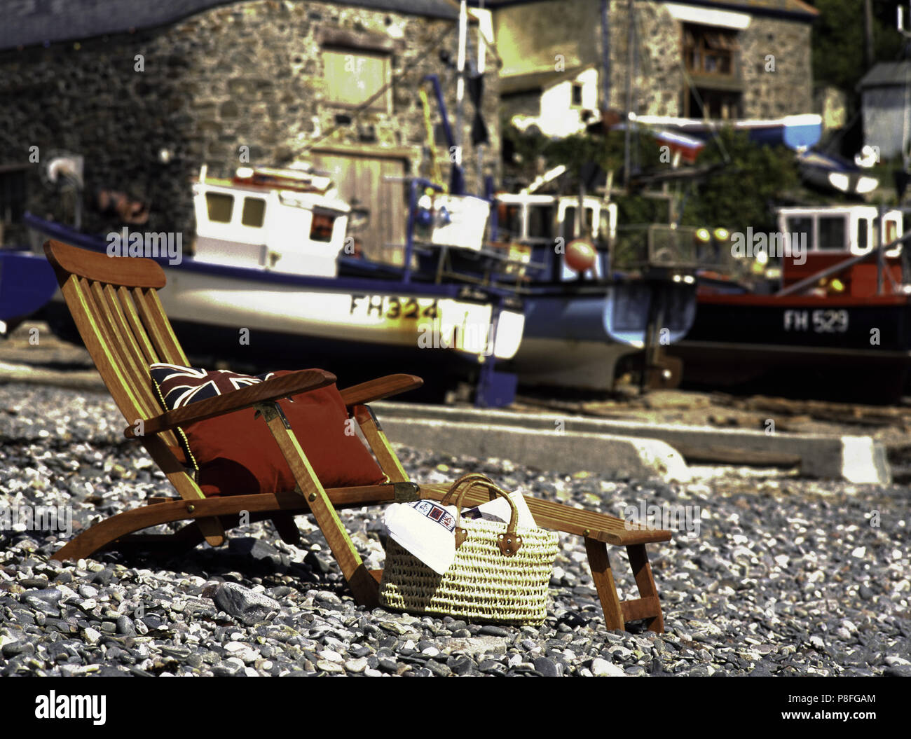 Restored Vintage Wooden Steamer Chair On A Pebble Beach With Boats In The Background Stock Photo Alamy