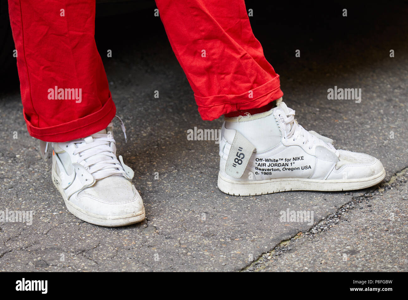 sports shoes 4fb5f 0ad2e MILAN - JUNE 16  Man with Nike Off White sneakers and red trousers before  Marni