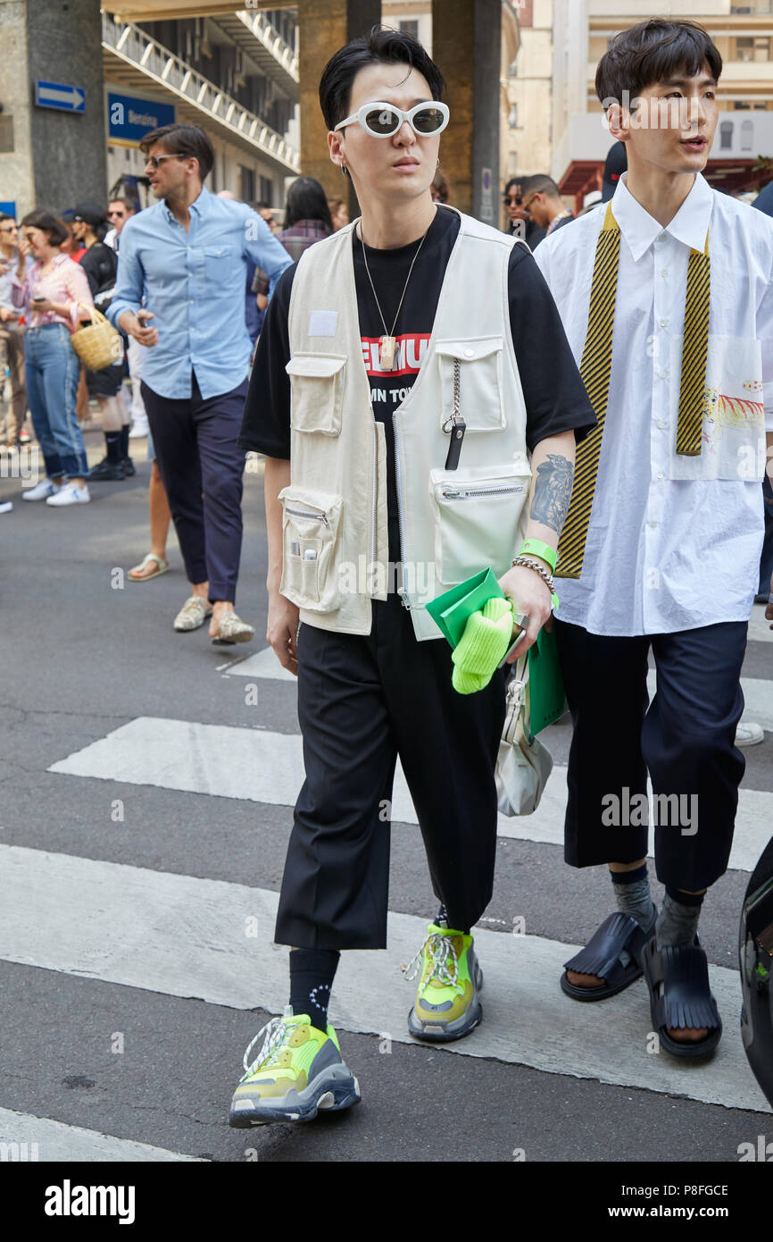 autorità wrongdoing poi  MILAN - JUNE 16: Guest with yellow green Balenciaga shoes, beige ...