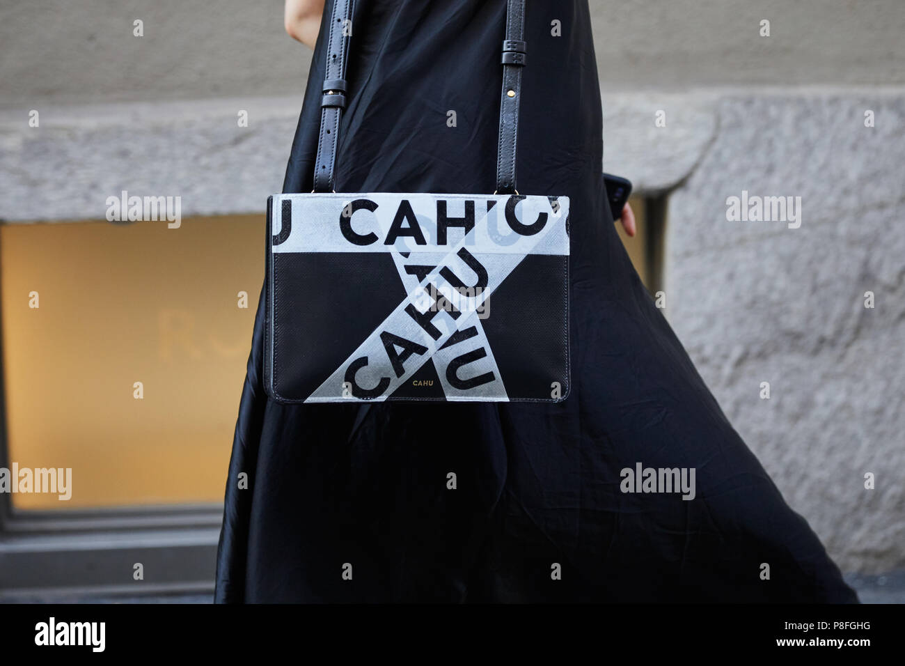 8eb1da54fdc MILAN - JUNE 16  Woman with Cahu black and white bag before Versace fashion  show