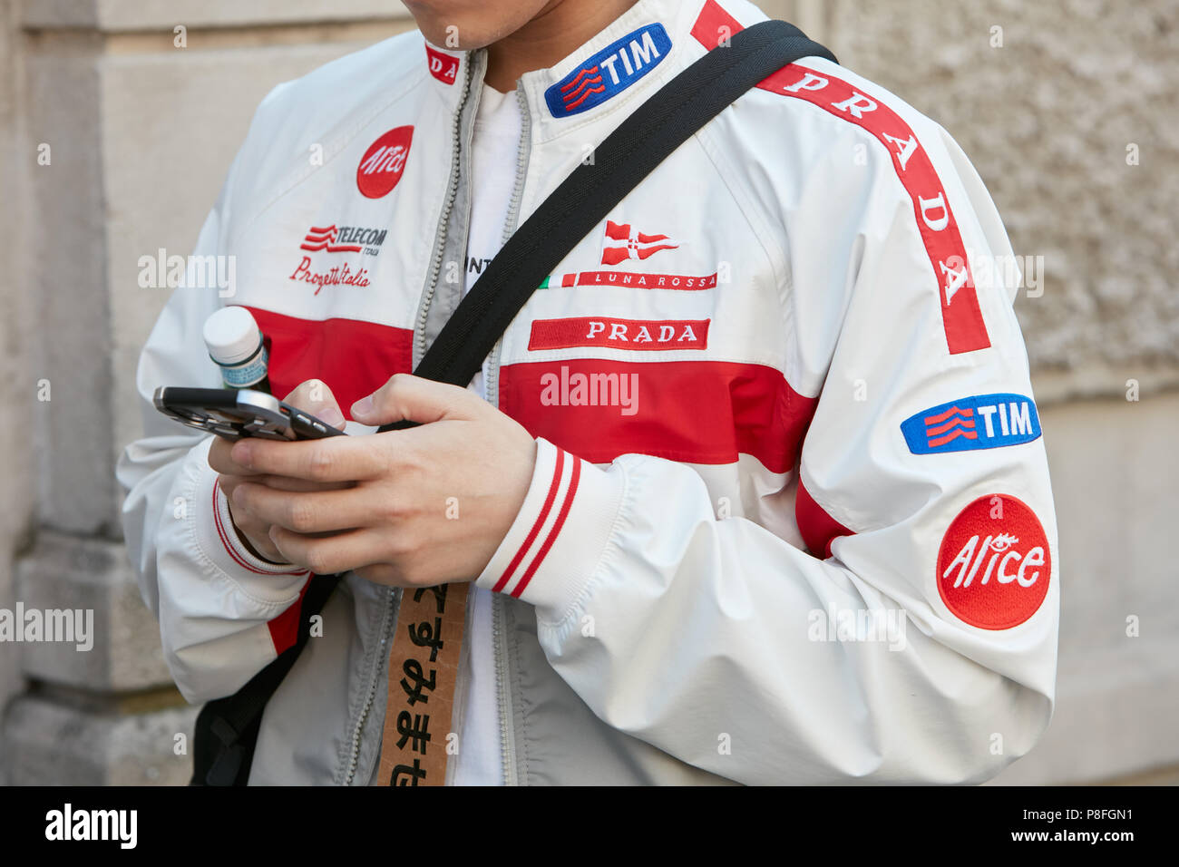 580dae712a329 MILAN - JUNE 17: Man with Prada Luna Rossa jacket looking at ...