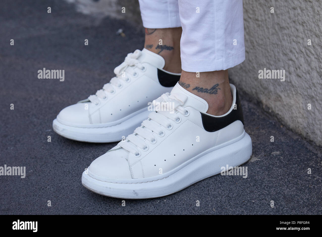 14429620e305 MILAN - JUNE 17  Man with white and black sneakers before Isabel Benenato fashion  show