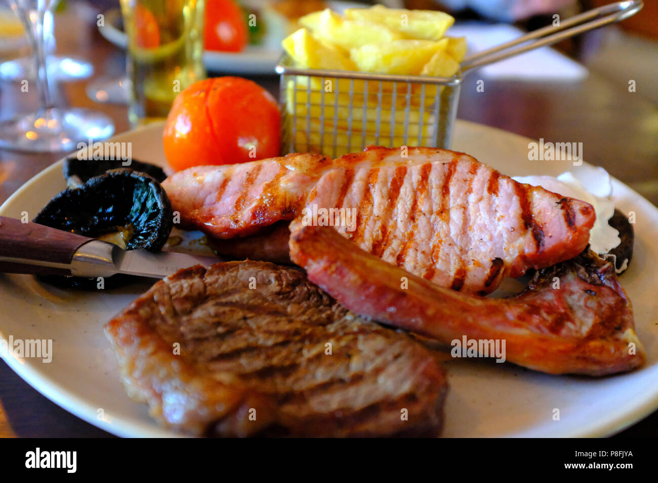 Mixed Grill cooked on a plate - Stock Image