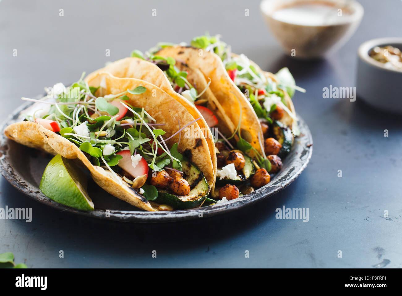 Vegetable tacos on blue background - Stock Image