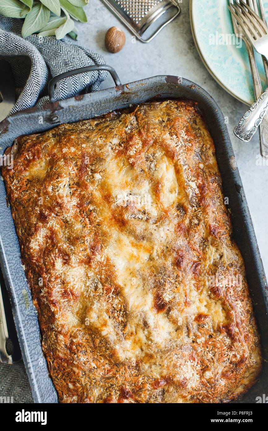 Lasagna in vintage pan - Stock Image