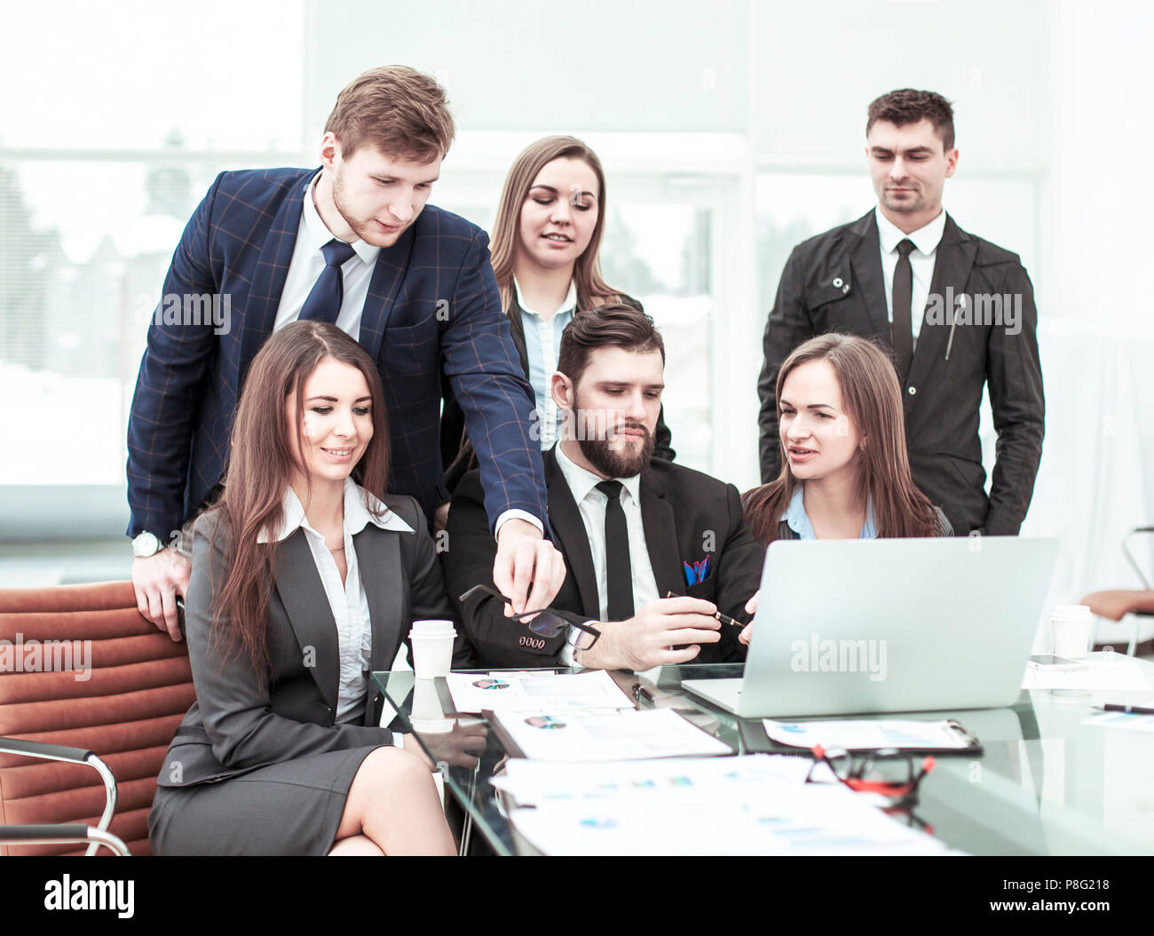 concept of teamwork - a successful business team in the workplace in the office - Stock Image