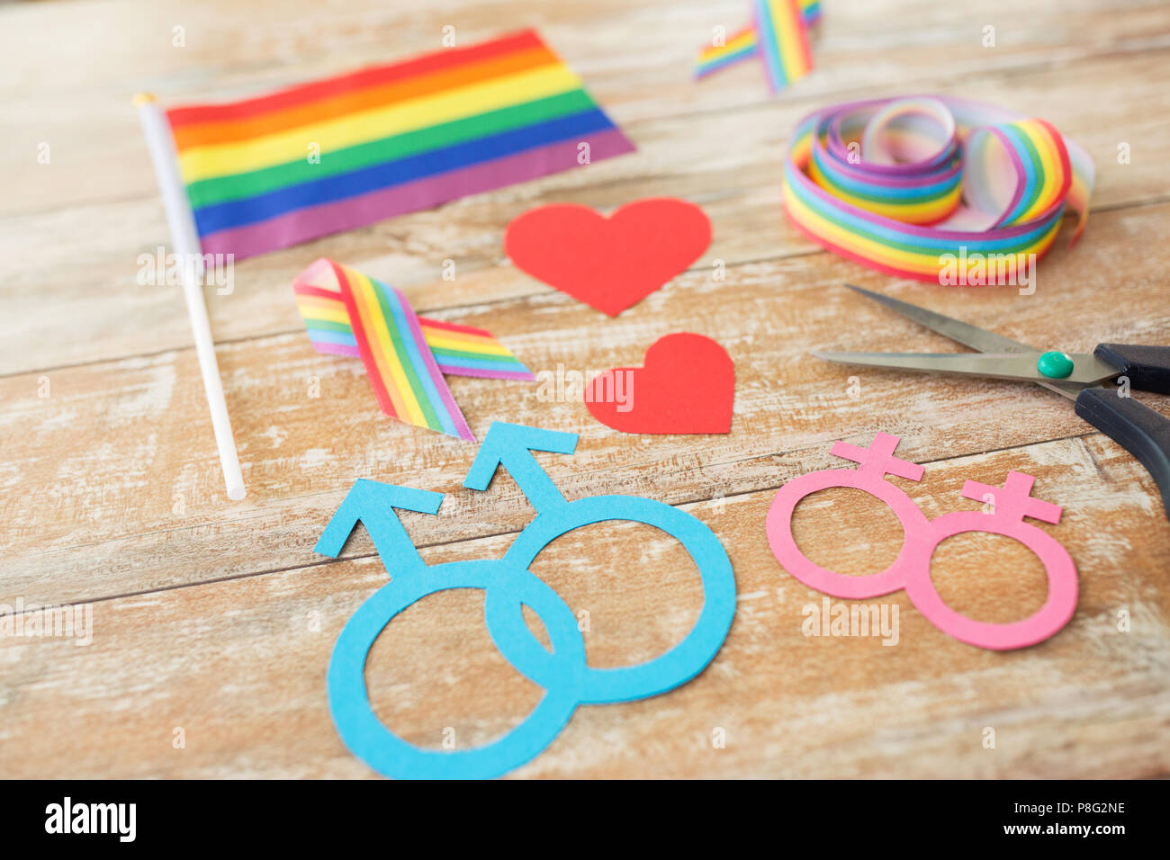 scissors and gay party props on wooden boards - Stock Image