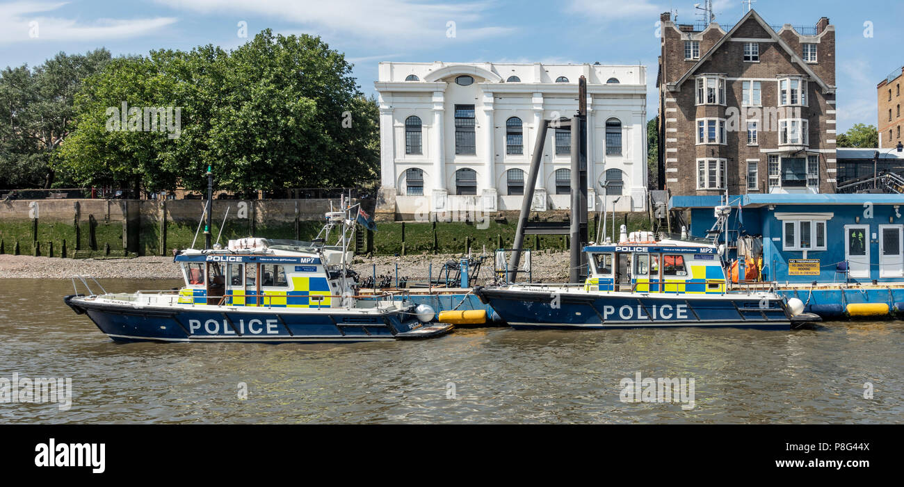 The Metropolitan Police Marine Policing Unit patrol boats MP7: Nina MacKay II and MP2, John Harriott IV, moored ready for action at the pier, Wapping - Stock Image