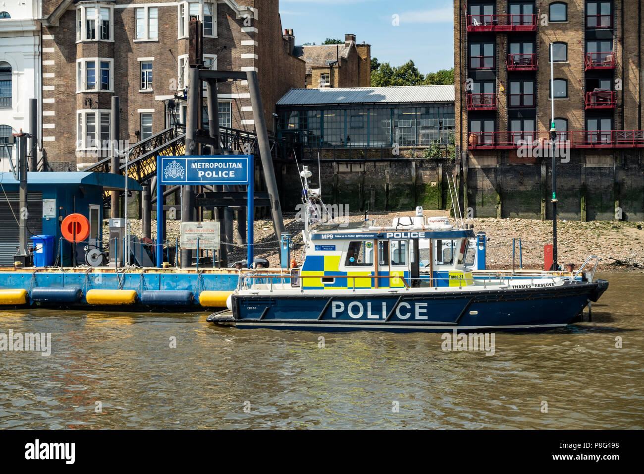 The Metropolitan Police Marine Policing Unit patrol boat MP9: Thames Reserve, moored ready for action at the pier in Wapping, east London. - Stock Image
