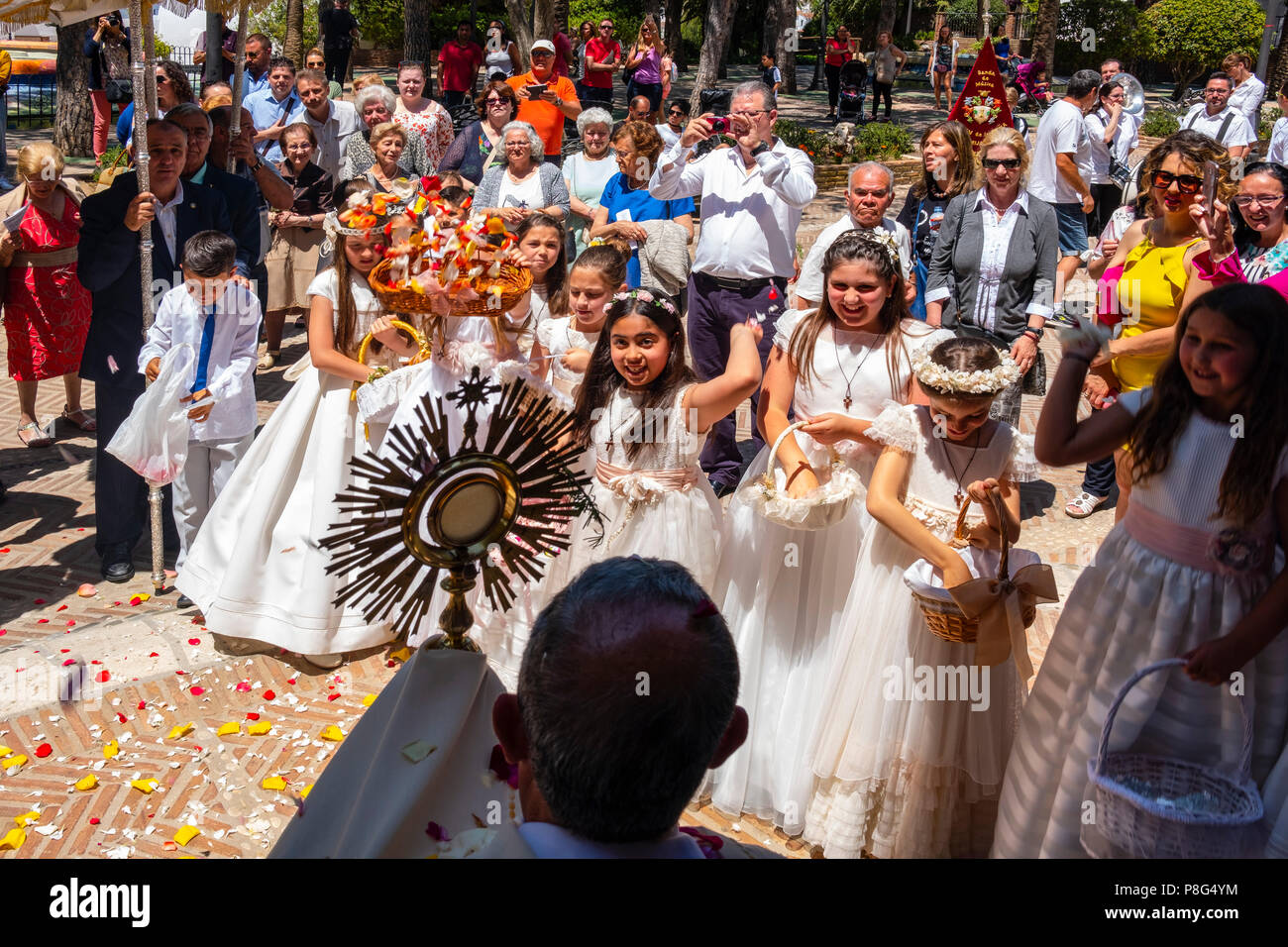 Celebration of Corpus Christi procession, typical white village of Mijas. Costa del Sol, Málaga province. Andalusia, Southern Spain Europe - Stock Image