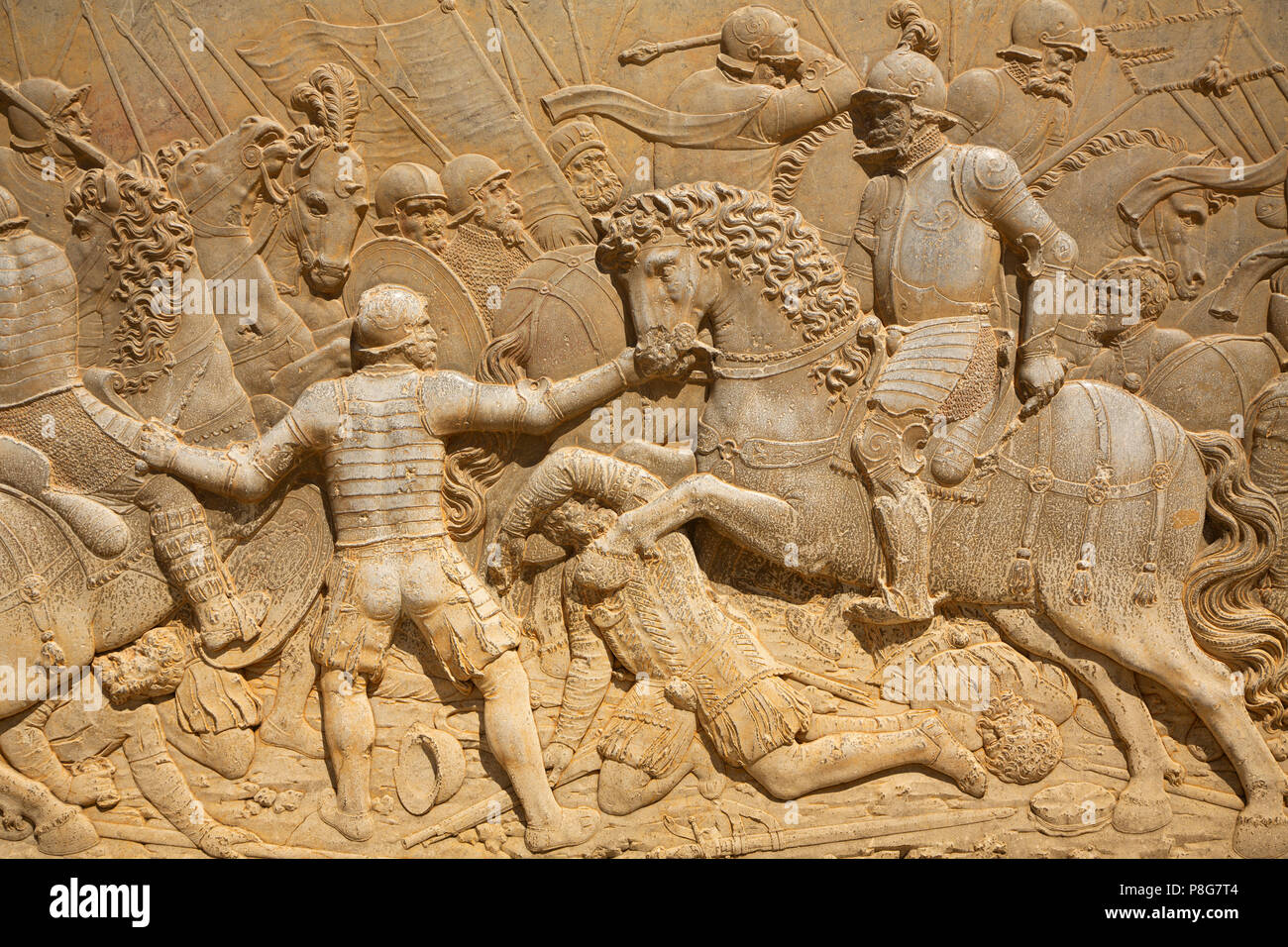 Relief carving of a battle scene. Palacio de Carlos V. Palace of Charles V. Alhambra, UNESCO World Heritage Site. Granada City. Andalusia, Southern Sp Stock Photo