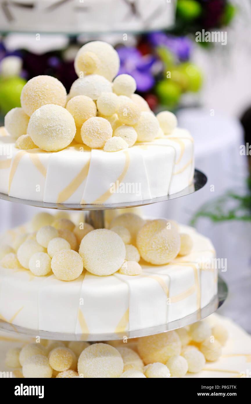 Fancy delicious white and yellow wedding cake Stock Photo: 211799075 ...