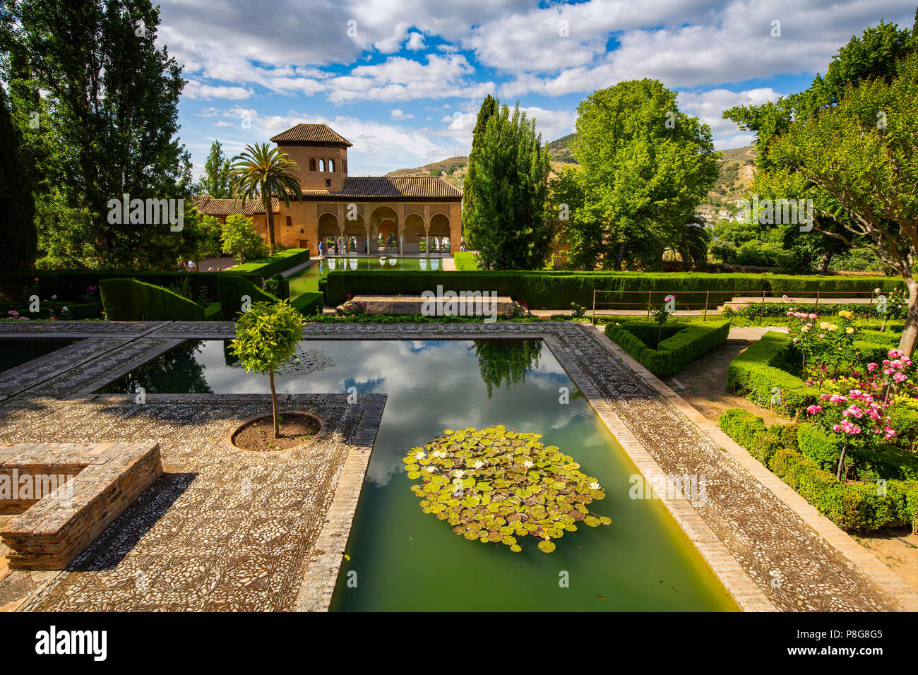 Torre de las Damas. Gardens, Alberca & fountains. El Partal, Nazaries palaces. Alhambra, UNESCO World Heritage Site. Granada City. Andalusia, Southern Stock Photo