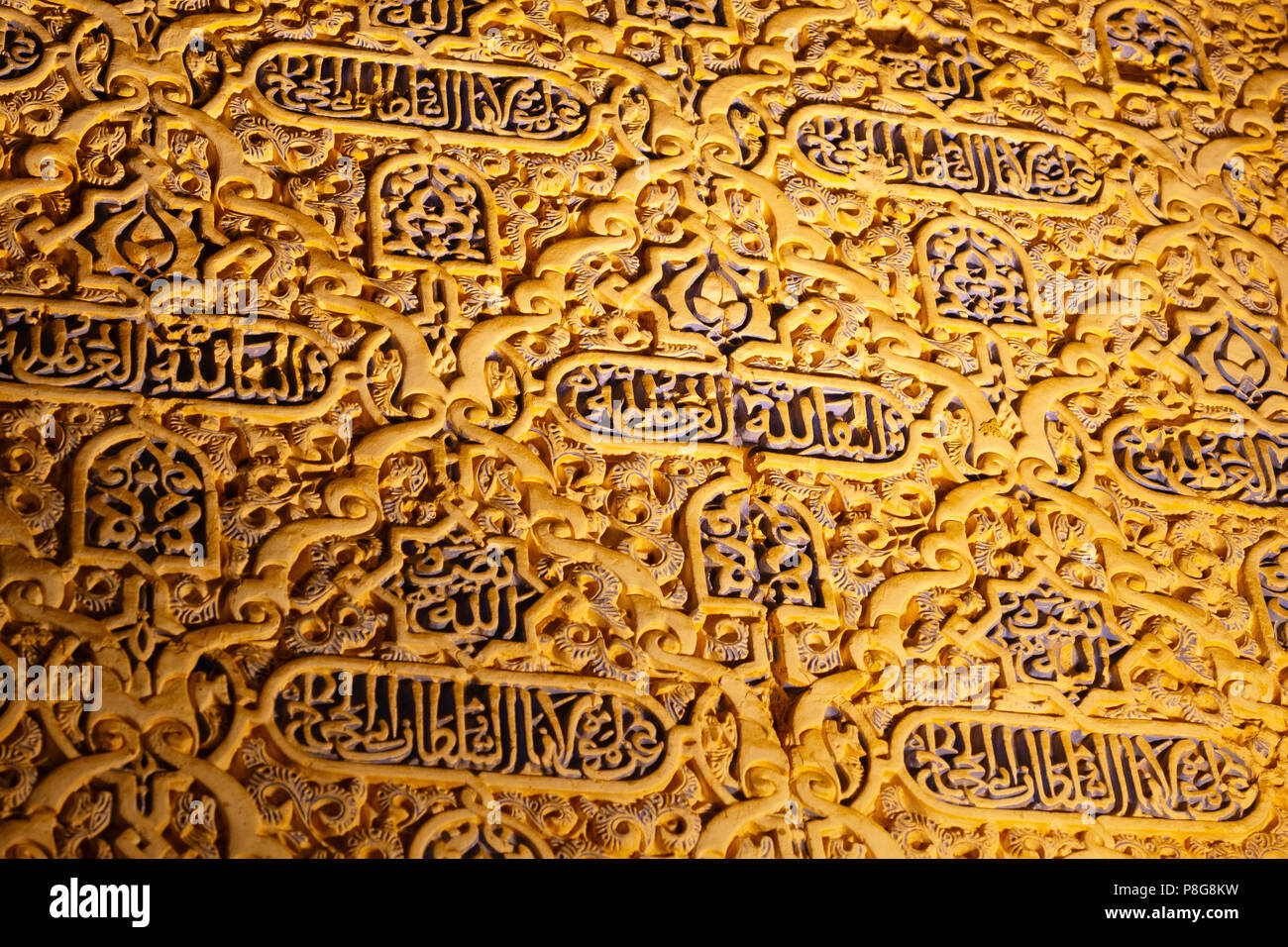 Decorative carving in wall plaster work in the Nasrid Palace. Alhambra, UNESCO World Heritage Site. Granada City. Andalusia, Southern Spain Europe Stock Photo
