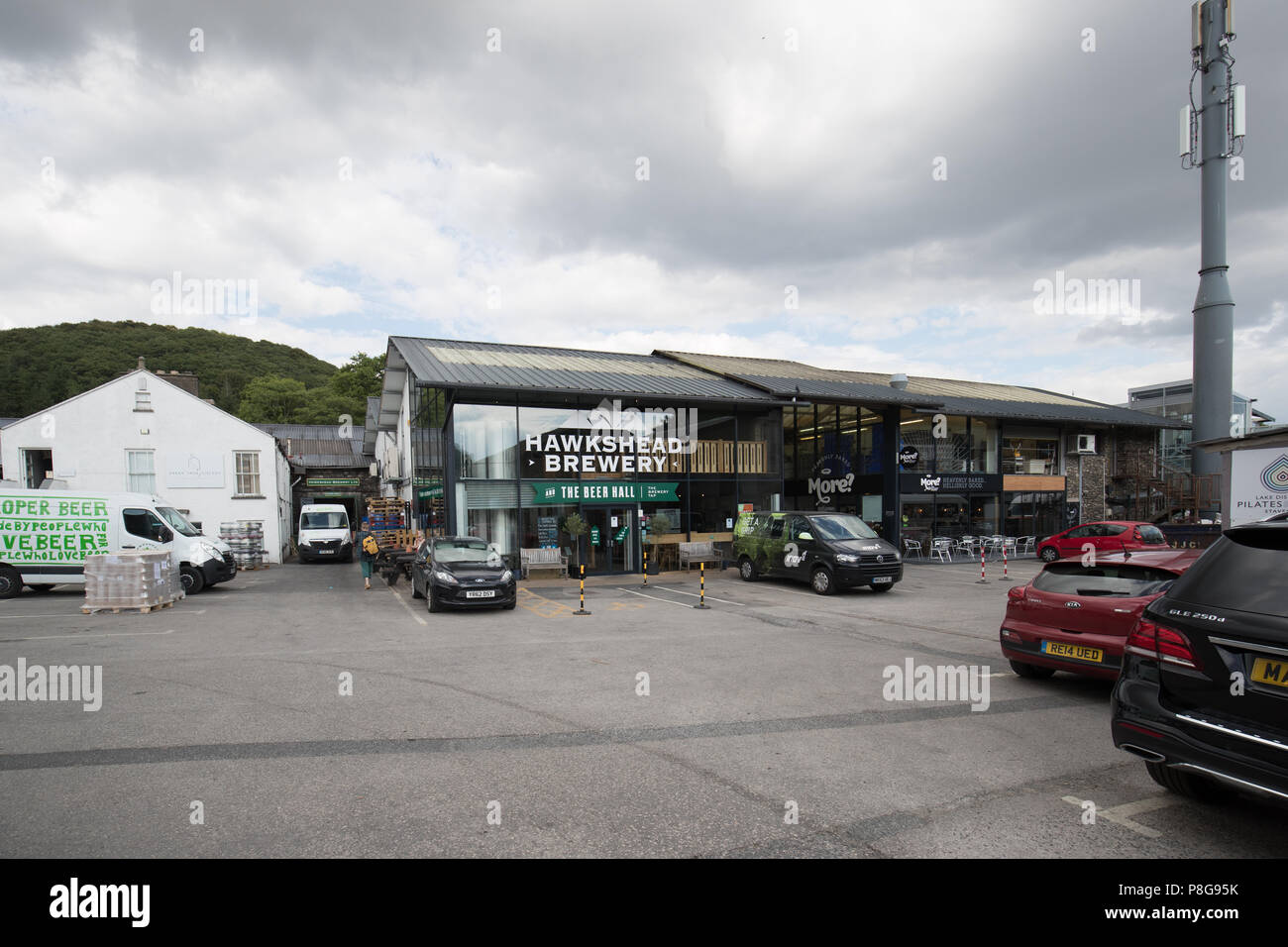 A village within a village, Staveley Mill Yard is a collection of businesses, both industrial and retail, Lake District - Stock Image