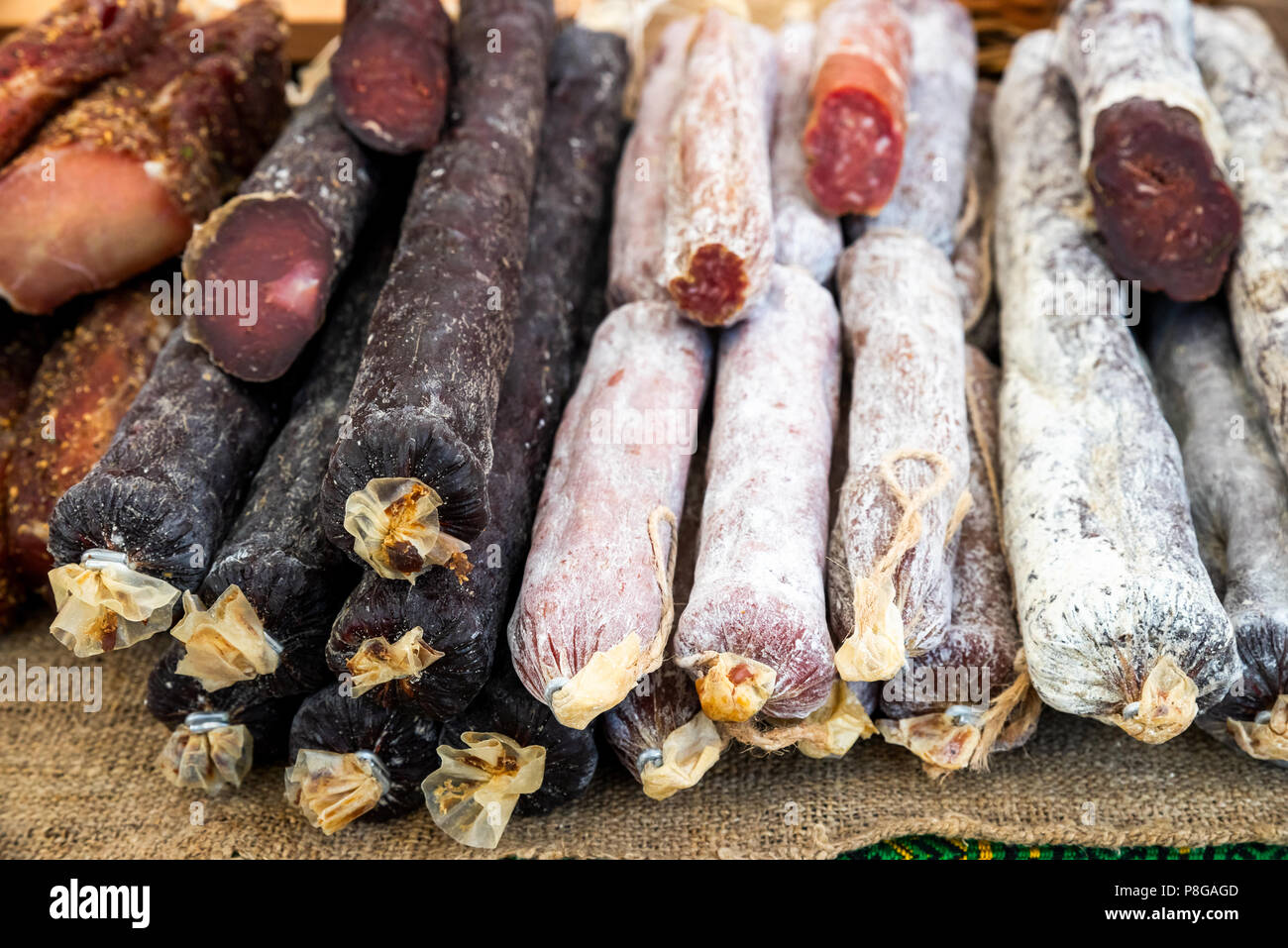 A lot of smoked sausage in the store - Stock Image