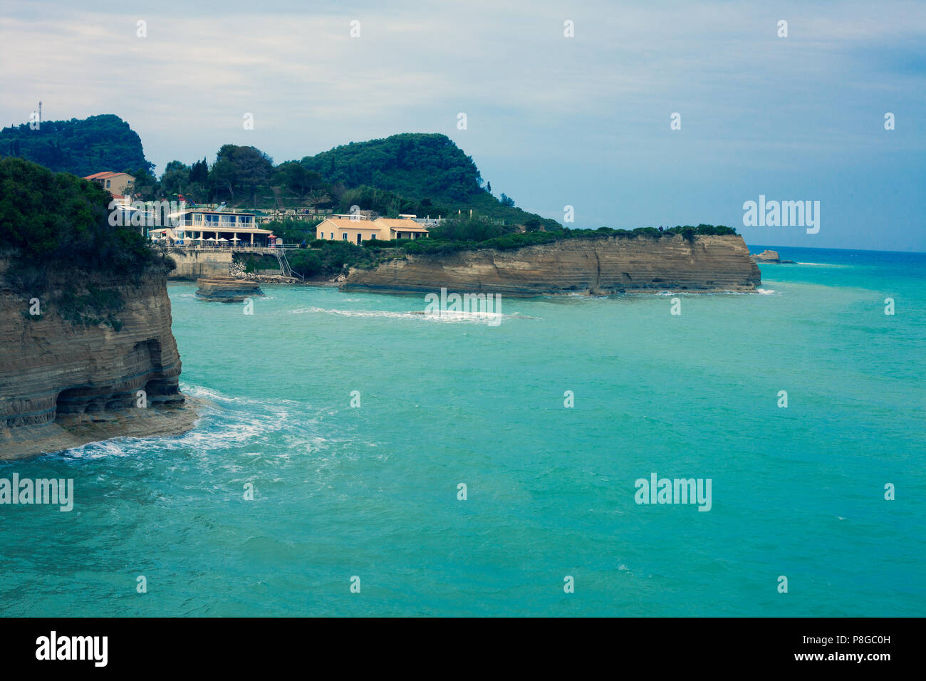 Mediterranean Exclusive Destination at the Coastline of the Blue Sea, Luxury Houses Located at the edge of beautiful mountains with Oceanview Turquois - Stock Image