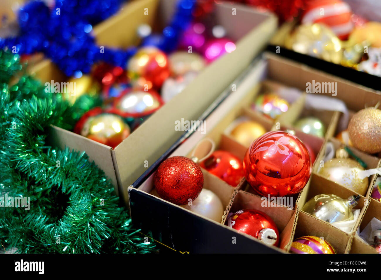 various colorful christmas decorations in a boxes