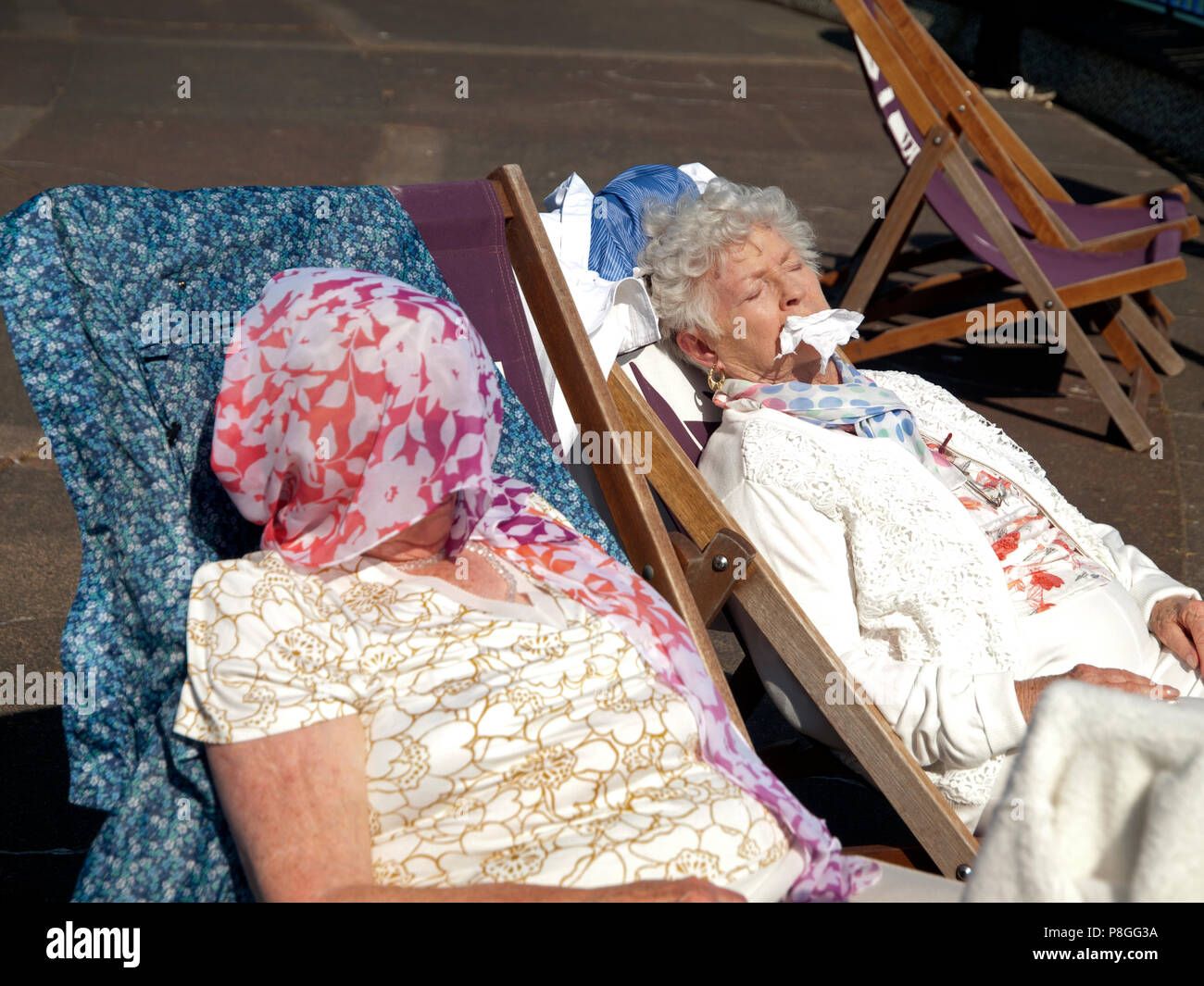 Enjoying a hot summer's day in Eastbourne - Stock Image