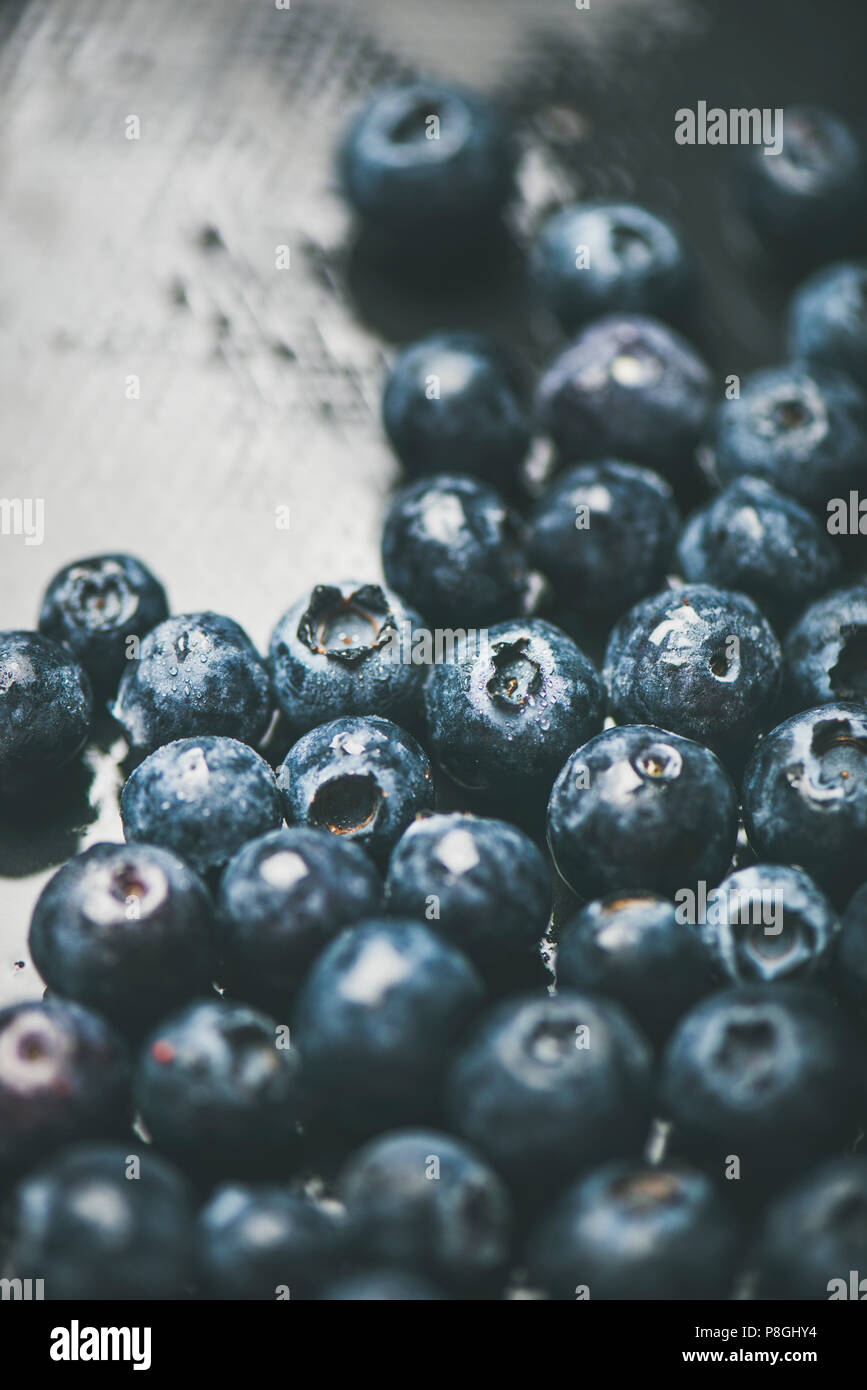 Fresh blueberry texture, wallpaper and background. Wet dark forest blueberries on dark background, selective focus. Summer food or local market produc - Stock Image