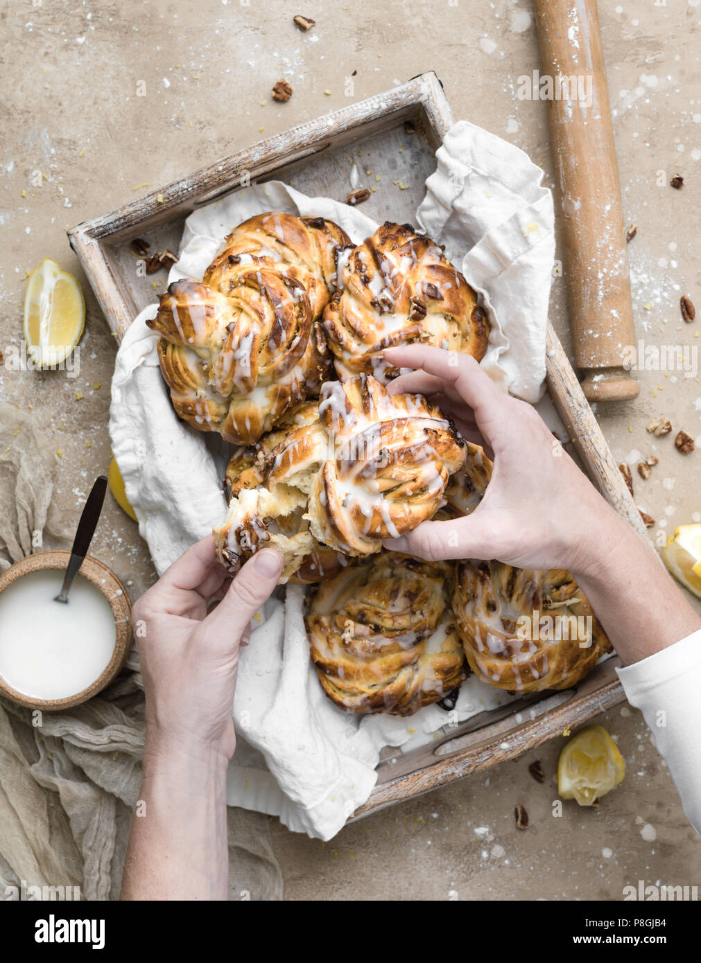 Lemon Pecan Sticky Buns made with lemon curd and chopped pecans. - Stock Image