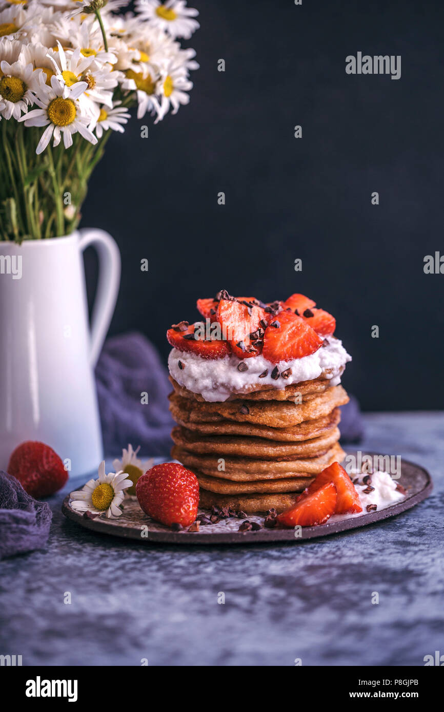 Stack of pancakes with strawberries and cream Stock Photo